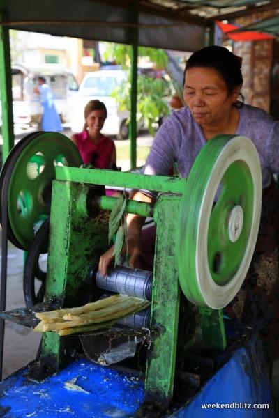 Pressing sugar cane into a delicious juice